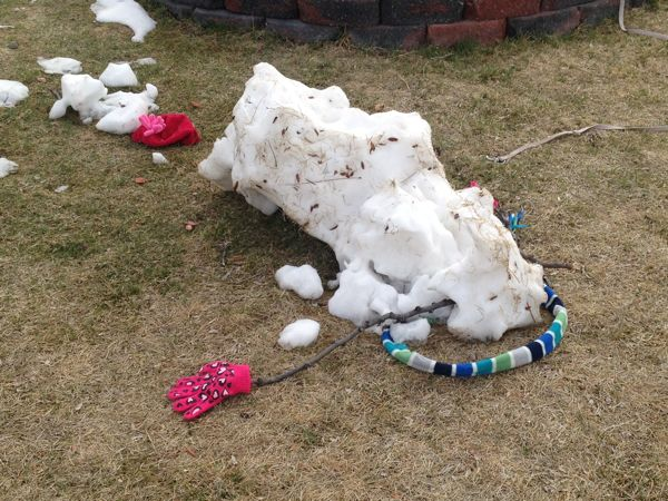 This poor, dead snowman spotted on today's run just about expresses how I feel after putting in significant miles.