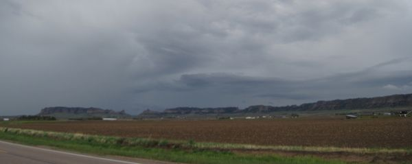 A look back at the dark clouds above Scotts Bluff.