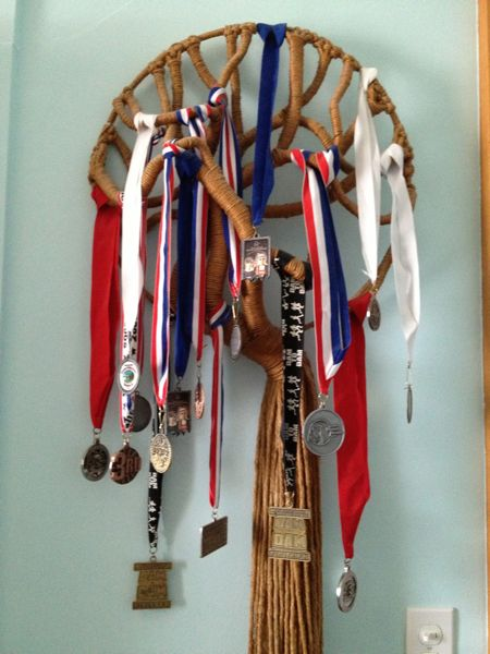 Bugman and I keep the finisher and placer medals from our various races on a macrame tree my mom made in the 1970s. No Maple Grove Half Marathon finisher medal on my tree, even though I finished. :-(