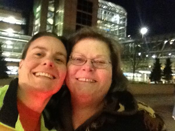 "A cellphone picture of me and my mom at the airport when she was dropping me off to fly home. My mom is an awesome ""race mother."" She let me cook fish tacos the night before the race, got me my favorite pre-race food, dropped me off at the race and picked me up afterwards, cheered for me during the race, picked me up and dropped me off at the airport, organized a dinner after the race so I could see aunts and uncles and cousins I had not seen in a long time, cooked stuffing and mashed cauliflower for that meal because that's what I wanted to eat after I ran. It's tough to run distance races, but it's easier if you have support. Thanks, mom!"