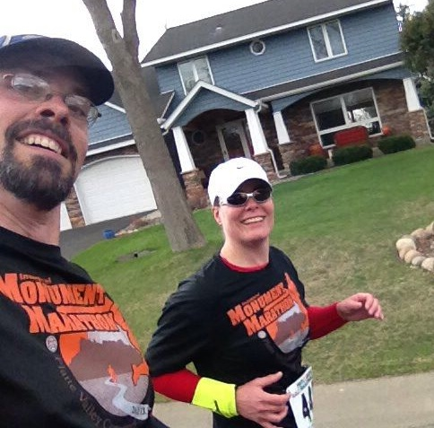 Bugman took a cell phone pic of us on the course. This is maybe around mile 7 or 8. Too bad it was in a random neighborhood and not in one of the lovely wooded glens along the course. Oh well. We are both smiling. Are are also both wearing our Monument Marathon shirts, in hopes raising awareness of the newest marathon in Nebraska, which we are helping plan.