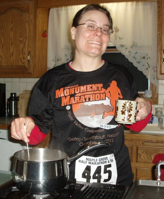 Cooking my pre-race ritual food of steel-cut oats in my mom's kitchen, holding good-luck coffee in a mug that belonged to my grandmother. My mom bought Reese's Pieces for me, too. At Sam's Club. The bag was the size of a small pillow. Thank goodness plenty of relatives came visiting later to help eat them all up!