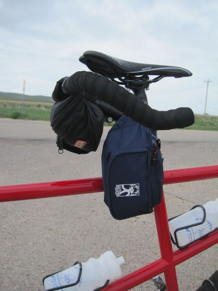 Fanny packs with straps wound around the bicycle frame make OK gear bags.