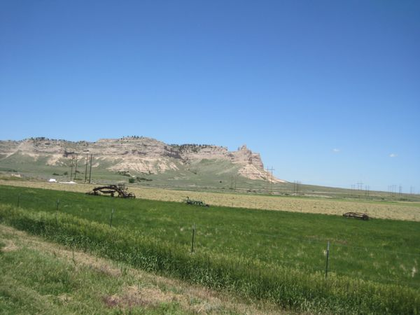 Mile 13.5: looking northwest at some property belonging to the Legacy of the Plains Museum / Farm And Ranch Museum, with Scotts Bluff National Monument in the background.