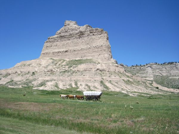 "Mile 14.5: looking north. Perfect timing to catch the pioneer wagon and ""oxen"" on the Oregon Trail at Scotts Bluff National Monument."