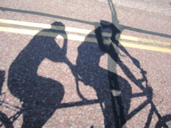 Our shadow on the road. Normally, we don't ride this late in the day. It's a good thing it was summer with long-lasting sunlight, as we didn't get home until 8:30 or so. An aside: it's not fun to bike on tarred road cracks parallel to your direction of travel.