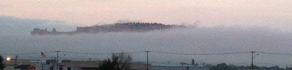 Morning fog obscuring the bluffs.