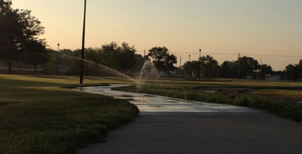 "My nemesis on morning runs: automatic sprinklers watering the sidewalks. Though there can be a benefit to them. I saw a little girl and her mom, arms up, doing the ""crossing the finish line"" pose. They were running through a sprinkler together."