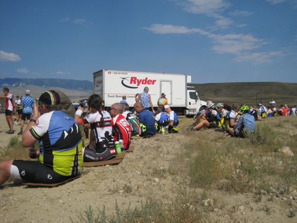 Our lunch stop on rocky high desert soil was buffered by cardboard boxes under our bums.