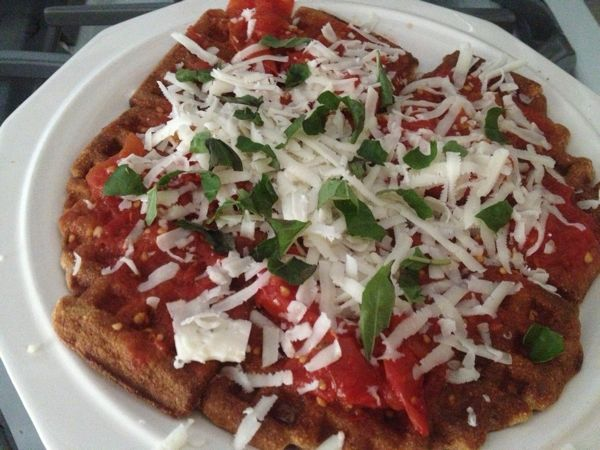 Homemade waffles made with locally-grown wheat flour that is coarse ground and kind of crunchy, topped with butter and stewed garden tomatoes (no additives, just cooked-down tomato goodness), topped with shredded Meadowlark goat cheddar from Victory Hill Farm, plus basil from the garden. A friend suggested this type of savory waffle, and, boy, was it scrumptious!