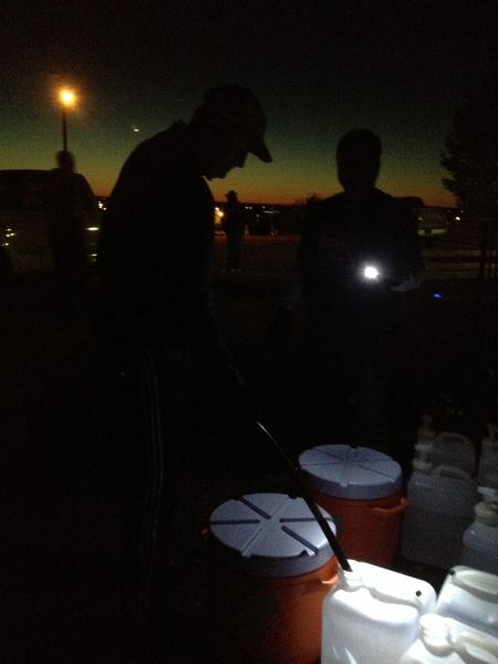 "Volunteers for the marathon were up before dawn, taking care of such details as aid station water ""cubitainers."""