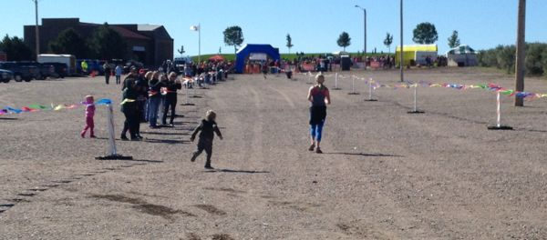 This little guy popped out of the supporter crowd to follow his mom at the finish.