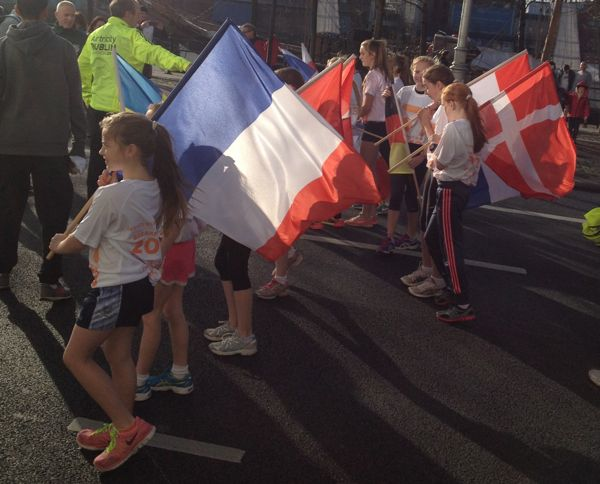 At the head of the pack were kids with international flags.