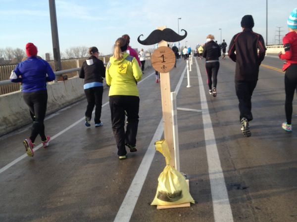 "All the mile marker signs had mustaches on them! (And, yes, that is a ""baby on board"" sign on that runner's back.)"
