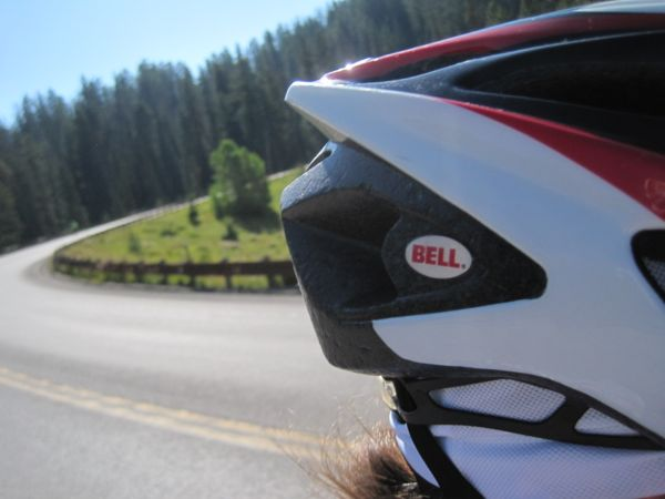 I was so excited to finally be over the peak of that climb, I wanted to document it with a photo, despite simultaneously wanting to hang onto the bike for dear life as we picked up speed on the descent. I wound up getting a nice photo of the back of my helmet as I pointed the camera upslope behind me.