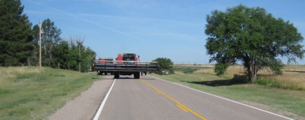 The combines pulled over into a driveway for Oliver Reservoir so we could pass them safely. Thanks, guys!