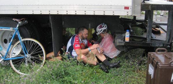 Any port in a storm! Many cyclists took refuge under the lunch truck. Hey! I recognize those cyclists! It's Kurt and Rhonda from Georgia!