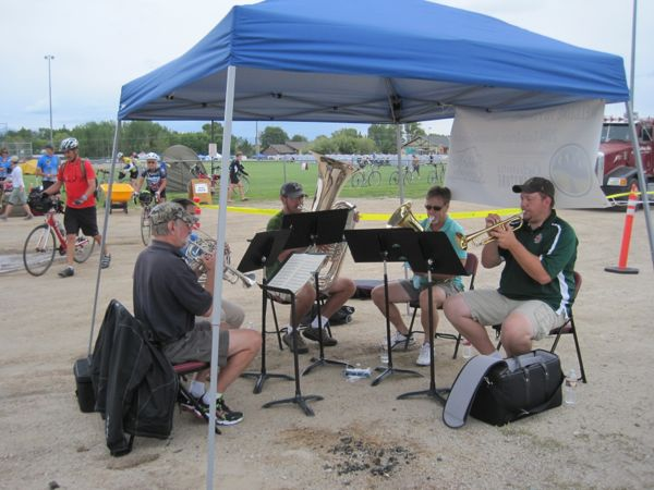Pinedale welcomed us with a brass quartet. It made me grin. That last few hundred feet up to the campsite did not make me grin, however. The bike path into the park where we camped was about a 75-foot climb over such a short distance that I about felt like I was going to tumble backwards off the bicycle. Yikes! I did love that campsite, though. It was delicious to camp on the thick, green grass in that park. I took my bike shoes off and walked around barefoot for the first time in days. Ahhhhh!