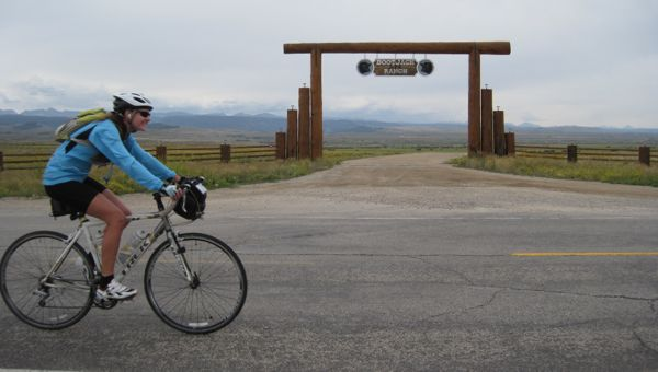 I offered to take a photo of a fellow cyclist as she stood under this ranch gate with the Wind River Range in the background. As I was taking the photo, a group of cyclists passed, and I got a great photobomb of one of them dominating the frame. Since that was on someone else's camera, I decided to try to recreate the effect with the next cyclist who came along, who apologized as she went by. No apologies! I was shooting across your lane of travel - you have the right of way! :-)