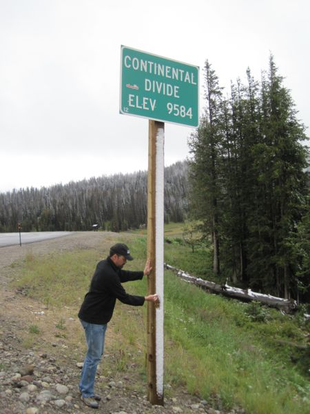 Bugman scrapes some snow off the continental divide sign to throw the first snowball of the season. I am so bummed I did not think to make and photograph a miniature snowman. That would have been my earliest-ever snowman, on August 24!