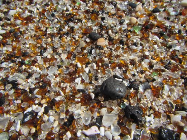 Nonsequitur image, but interesting in comparison. This is a photo from Glass Beach - literally a dump - which has become a tourist attraction because of all the beach glass. There were no pieces of beach glass larger than grains of sand because they all get picked up by tourists. Some people even take home jars full of this beach sand, leading to complaints about destruction of this attraction. I wonder, though - is it really a genius campaign to get tourists to clean the trash off beach?