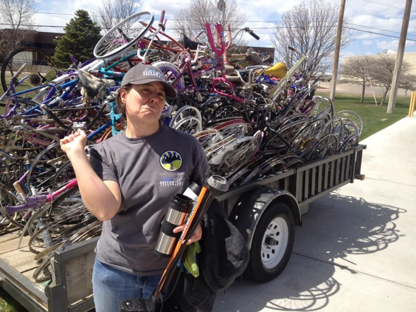 Me, soliciting sympathy for my scratched arm, standing in front of the pile of stripped bicycle carcasses destined for recycling / repurposing. Photo by Bugman