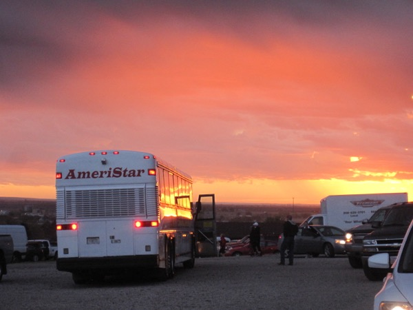 The sunrise was incredible on Year 1 of the Monument Marathon in 2012. Here was the shuttle bus that year, in the parking lot of Five Rocks Amphitheater, ready to take full marathoners to their race start in the Wildcat Hills.