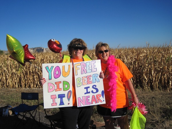 An Elmo balloon photobombs these colorful race fans from the 2014 Monument Marathon.