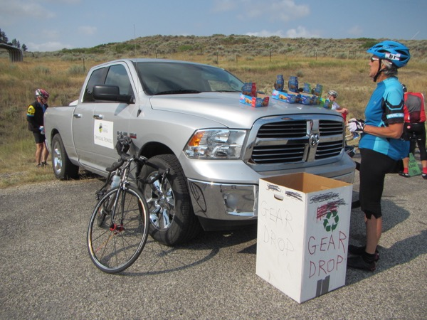 A typical recharge stop: (cereal) bars on cars (or pickup trucks). Also, gear drop boxes, where you can offload the warm things you put on that morning when it was still cold out.