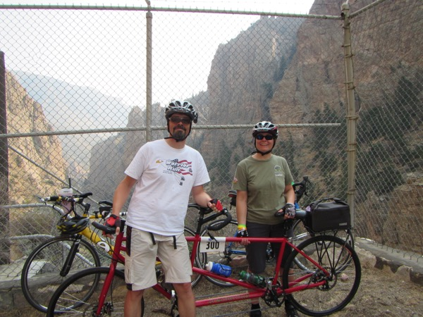 "We asked a random fellow cyclist to take our picture partway down the dam road. We were in our ""civvies"" that day. No need for a bike kit for such a short ride."