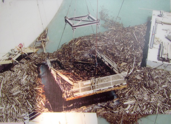 A picture of a picture from inside the visitor center, of one of the ways the floating debris is periodically cleaned up.