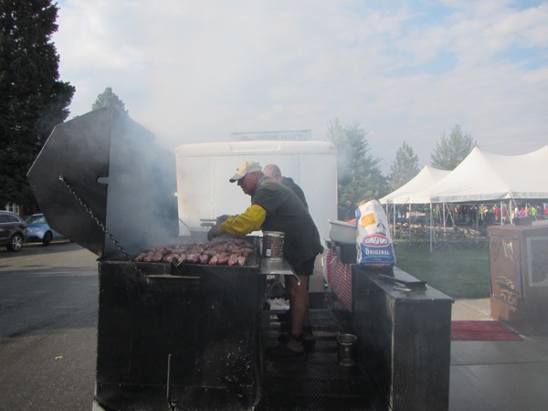 Thankfully, the rain quit and the sun came out again. The catering crew cooked meat for dinner on a giant BBQ grill.