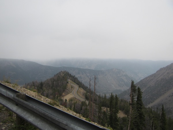 10 a.m.: we've climbed up far enough to look down on the rest stop. The drizzle is changing to snow.