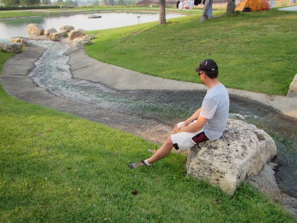 Awhile later, I was looking for Bugman and found him sitting on a rock next to the faux stream. That really is a beautiful library campus.