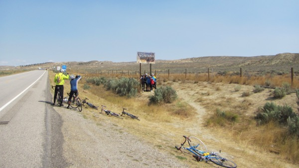 Some cyclists commemorating their passage back into Montana at mile 42.