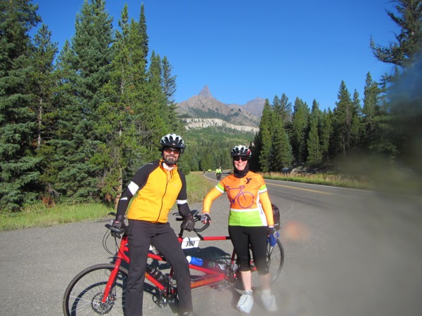 We asked a random fellow cyclist to take our picture with Pilot Peak in the background. (Oops! There was a little condensation on my camera lens.)