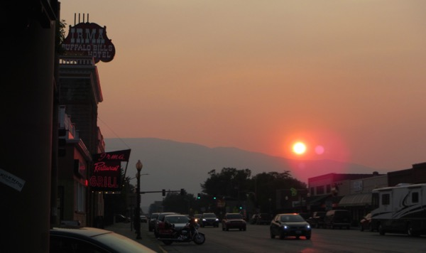 A shot of the smoky sunset, looking west down Sheridan Drive past the historic Irma.
