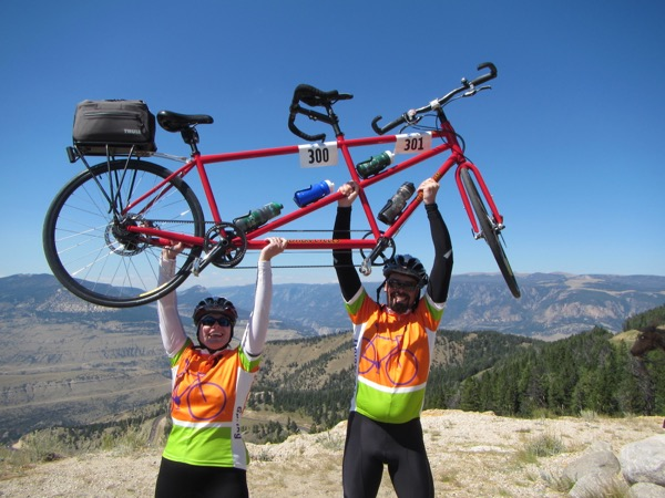 Have to post a repeat of our triumphant summit pic from the day 0 post. It was a good day on the bike!