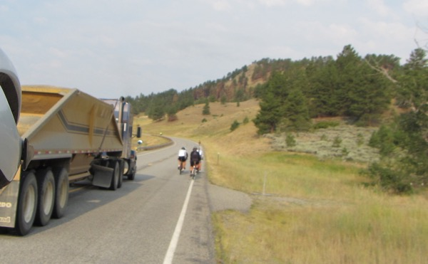 Here was one of the many semi trucks that passed us along the route. Not this truck, but the one before it, could be heard laying on the horn up the hill a ways as it passed the group of cyclists in the picture, perhaps because they weren't riding single file?