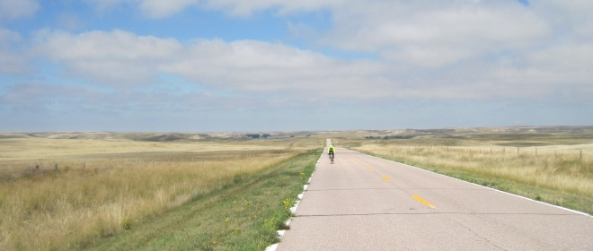 A rider southbound on Highway 71 passes through gorgeous High Plains scenery enroute from Agate Fossil Beds National Monument to Scotts Bluff National Monument.